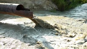 Sand dredging tube. Pipe of sand dredging boat cleaning river bed. Ecological concept.  stock video