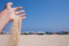 Sand drop down from hand in sardegna Royalty Free Stock Images