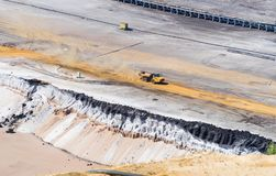 Sand dump truck in an open pit mine. HOCHNEUKIRCH, GERMANY - JULY 7, 2018: Sand dump truck transporting sand in the Garzweiler brown coal mine stock photos