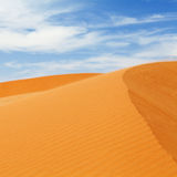Sand dune. With blue sky in the namibian desert Stock Photos