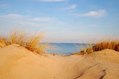 Sand dune. Sea and sky Royalty Free Stock Image