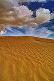 Sand dune. Part of the landscape of the desert called the Sahara in Tunisia with sandy dune and rain clouds Stock Photos