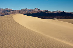 Sand Dune. And mountain range in Death Valley National Park, California royalty free stock photography
