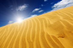 Sand dune. Desert concept, sand dune and blue sky royalty free stock photo
