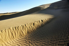 Sand dune with blue sky Royalty Free Stock Image