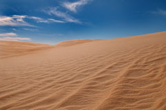 Sand Dune and Blue Sky Royalty Free Stock Photos