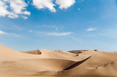 Sand Dune with Blue Sky Stock Image
