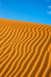 Sand dune with blue sky Stock Photography
