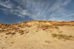 Sand dune with blue sky Stock Photo
