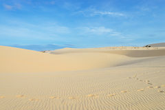 Sand dune and blue sky Royalty Free Stock Image
