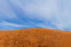 Sand dune and the blue sky Stock Photos