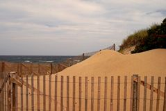 Sand dune on Cape Cod. Large sand dune on Cape Cod beach in the summer stock photos