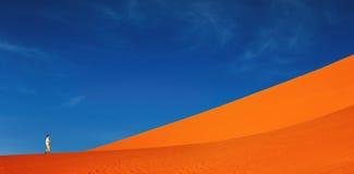 Sand dune climbing Stock Photo