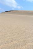 Sand Dune. Close up sand dune and blue sky Royalty Free Stock Images