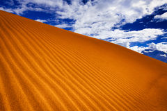 Sand dune in desert under blue sky. Abstract texture of sand dune in desert under blue sky Royalty Free Stock Photography