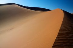 Sand dune of Erg Chigaga. With its curves separating shade from lit part Stock Images