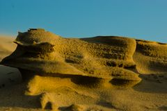 Sand dune eroded by the strong winds royalty free stock images