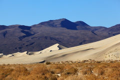 Sand dune in Eureka and  red rocks Stock Photo