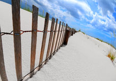 Sand Dune and Fence Stock Photography