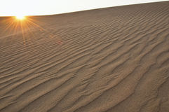 Sand dune with flare Stock Photos