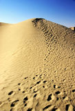 Sand dune with footprints Stock Photo