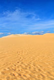 Sand dune with footprints Stock Photography