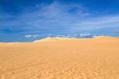Sand dune with footprints Royalty Free Stock Image
