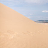 Sand dune with footsteps Stock Photo