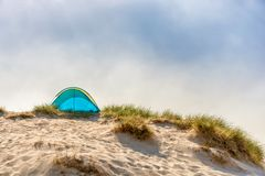 Beach shelter in the dunes of a beach stock photos