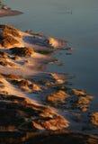 Sand dune lagoon. Setting Sun bathes dunes at Noordhoek beach,Cape Town Royalty Free Stock Photo