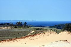 Sand dune with lake Stock Photo