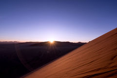 Sand dune lit by setting sun