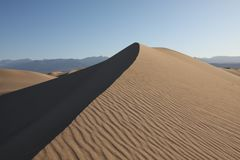 Sand dune on the morning Royalty Free Stock Photos