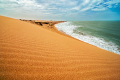 Sand Dune and Ocean. A view of the coastline as seen from the Taroa sand dune Royalty Free Stock Photography