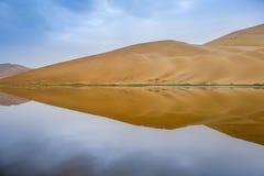 Badain Jaran Desert with lake and reflection royalty free stock photography