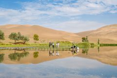 Badain Jaran Desert with lake and reflection stock photo