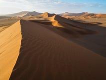Sand dune ridge in vast desert. Sand dune ridge with beautiful curve in vast desert Stock Photo