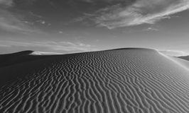 Sand dune with ripples in White Sands in New Mexico. Black and white view of large sand dunes in White Sands National Monument in New Mexico near Alamogordo Royalty Free Stock Images