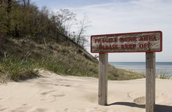 Sand dune sign. 'Keep off' sign posted in front of a sand dune Stock Photo