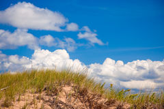 Sand dune and the sky. A sand dune on the coast of Prince Edward Island with beautiful summer sky in the background Royalty Free Stock Photography