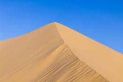 Sand dune in sunrise in the desert Royalty Free Stock Photos