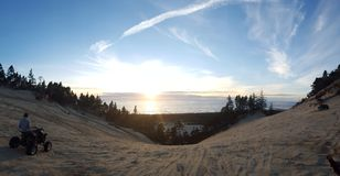 Sand dune sunset. At the top of Banshee Hill when the sun goes down stock photography