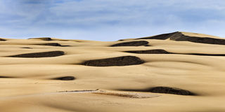 Sand dune tele spots pan stock photography