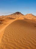 Sand dune. With two peaks in background royalty free stock photos