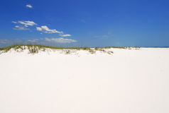 Sand Dune Under Blue Sky. Beautiful white beach sand under blue sky Royalty Free Stock Photo