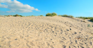 Sand dune under clouds Royalty Free Stock Images