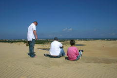 Sand Dune with a view. People enjoying the view from up top of a sand dune Royalty Free Stock Photo