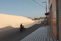 The sand dune and the village Royalty Free Stock Image