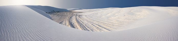 Sand Dune (White Sands of NM) Panorama. A dune of white sand in the White Sands National Monument, New Mexico, USA. The ridges on the ground are a product of the royalty free stock photo
