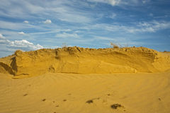 Sand dune whith blue sky. Sand dry yellow dune whith blue sky whith little clouds stock photo